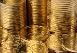 Extreme closeup of golden coins, columns and a heap